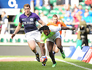 LONDON, ENGLAND - Saturday 10 May 2014, Seabelo Senatla of South Africa scores his try during the match between South Africa and Scotland at the Marriott London Sevens rugby tournament being held at Twickenham Rugby Stadium in London as part of the HSBC Sevens World Series.<br /> Photo by Roger Sedres/ImageSA