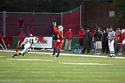 25 September 2010:  Tyrone Walker hauls in a pass as Jimmie Strong zeros in on his number.  The Missouri State Bears lost to the Illinois State Redbirds 44-41 in double overtime, meeting at Hancock Stadium on the campus of Illinois State University in Normal Illinois.