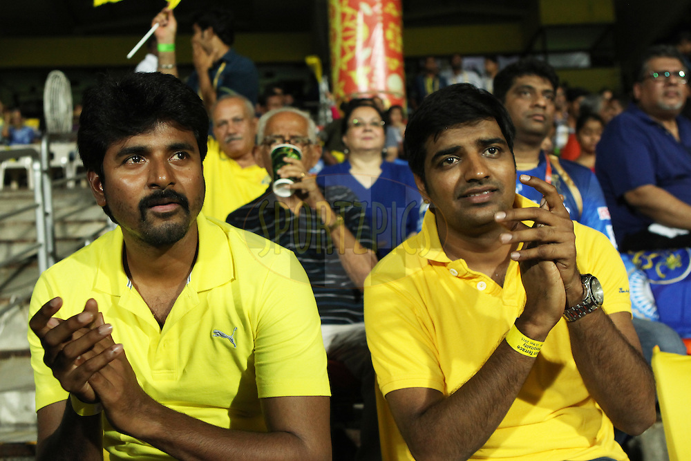 tamil actor Sivakarthikeyan(L) and Satish at gallery  during match 47 of the Pepsi IPL 2015 (Indian Premier League) between The Chennai Superkings and The Rajasthan Royals held at the M. A. Chidambaram Stadium, Chennai Stadium in Chennai, India on the 10th May 2015.<br /> <br /> Photo by:  Saikat Das / SPORTZPICS / IPL