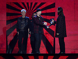 U2 on stage collecting the Global Icon award from Jared Leto during the MTV Europe Music Awards 2017 held at The SSE Arena, London. Photo credit should read: Doug Peters/EMPICS Entertainment