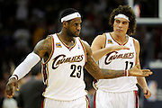 Apr 19, 2010; Cleveland, OH, USA; Cleveland Cavaliers forward LeBron James (23) reaches for a 'five' from teammate forward Anderson Varejao (17) during the fourth period against Chicago Bulls in game two in the first round of the 2010 NBA playoffs at Quicken Loans Arena. The Cavaliers beat the Bulls 112-102. Mandatory Credit: Jason Miller-US PRESSWIRE