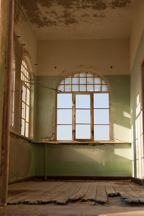Upstairs in a collapsing building in the abandoned mining town of Kolmanskop, Namibia