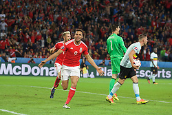 5LILLE, FRANCE - Friday, July 1, 2016: Wales' Hal Robson-Kanu celebrates scoring his sides second goal to make the score 2-1 during the UEFA Euro 2016 Championship Quarter-Final match  against Belgium at the Stade Pierre Mauroy. (Pic by Paul Greenwood/Propaganda)