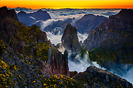 Dark rocks with clouds around between Pico Arieiro and Pico Ruivo at sunset