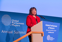 © Licensed to London News Pictures. 22/10/2018. Bristol, UK. Global Parliament of Mayors Annual Summit, 21-23 October 2018, at Bristol City Hall. Picture of PATRICIA DE LILLE, Mayor of Capetown, South Africa, addressing the conference. The Global Parliament of Mayors 2018 is the biggest and most ambitious Annual Summit to date. GPM Bristol 2018 will host up to 100 global mayors for an action-focused summit that addresses some of the biggest challenges facing today's world cities. GPM Bristol 2018's theme, Empowering Cities as Drivers of Change, will focus minds on global governance and the urgent need for the influence, expertise and leadership of cities to be felt as international policy is shaped. GPM Bristol 2018 will provide mayoral delegates with a global network of connections and a space to develop the collective city voice necessary to drive positive change. The programme will engage participants in decision-making, with panels, debate and voting on priority issues including migration and inclusion, urban security and health, and is a unique chance to influence decisions on the most pressing issues of our time. Photo credit: Simon Chapman/LNP