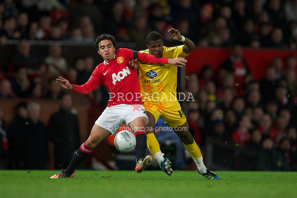 MANCHESTER, ENGLAND - Wednesday, November 29, 2011: Manchester United's Fabio Da Silva in action against Crystal Palace's Wilfred Zaha during the Football League Cup Quarter-Final match at Old Trafford. (Pic by David Rawcliffe/Propaganda)
