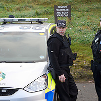 Perth Manhunt.....24.10.12<br /> Armed police officers pictured near Kinnoull Hill in Perth today joining a manhunt for prisoner Lee Cyrus who has absconded from North Sea Camp, Boston, Lincs..Police decended on the area around Kinnoull Hill sealing it off after a possible sighting of Lee Cyrus was reported using a helicopter and dogs to search the wooded Perthshire beauty spot.<br /> Picture by Graeme Hart.<br /> Copyright Perthshire Picture Agency<br /> Tel: 01738 623350  Mobile: 07990 594431