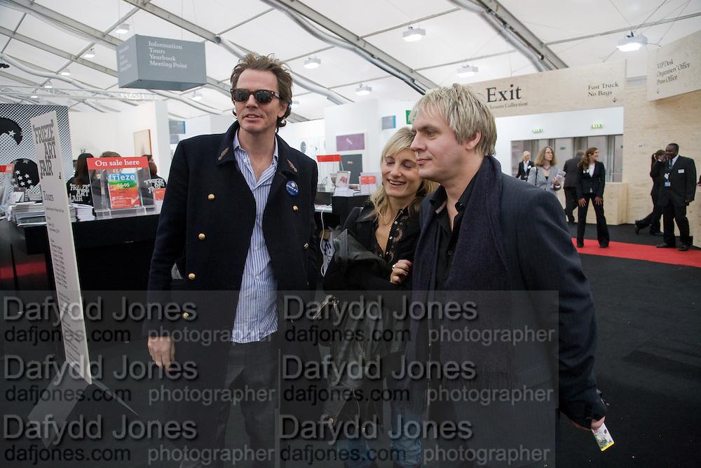 JOHN TAYLOR; VIRGINIA DAMPSTA; NICK RHODES, Frieze Art Fair 2008. Regent's Park. London. 15 October 2008 *** Local Caption *** -DO NOT ARCHIVE -Copyright Photograph by Dafydd Jones. 248 Clapham Rd. London SW9 0PZ. Tel 0207 820 0771. www.dafjones.com