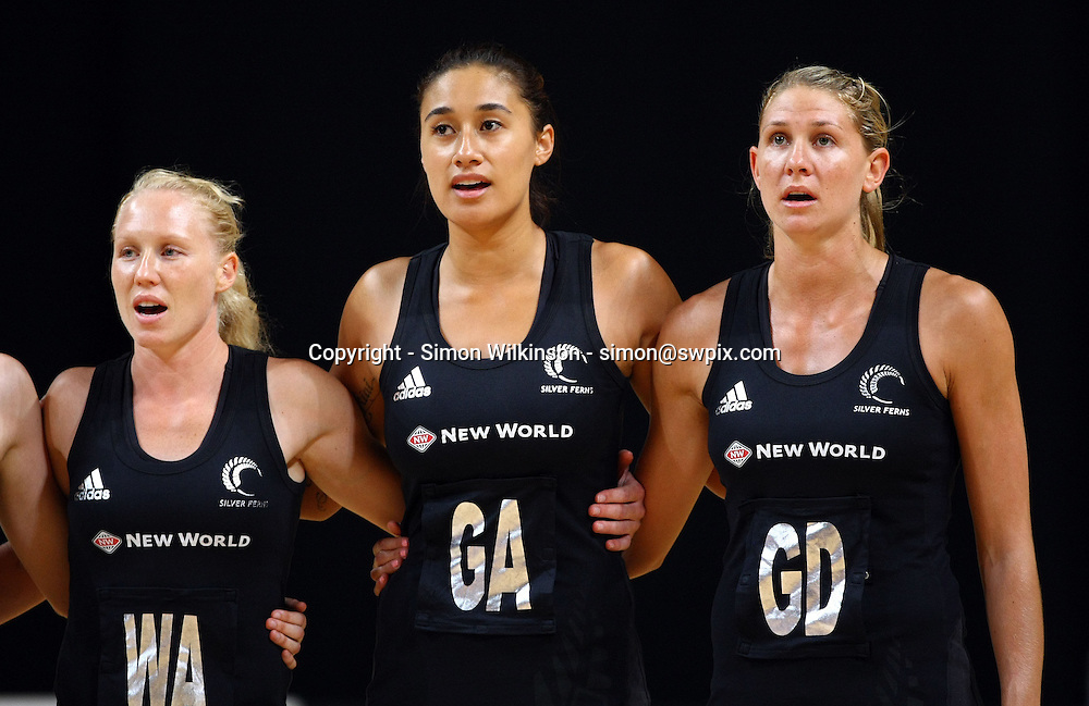 PICTURE BY VAUGHN RIDLEY/SWPIX.COM...Netball - International Netball Series - England v New Zealand - MEN Arena, Manchester, England - 15/01/11...New Zealand's Laura Langman, Maria Tutaia and Casey Williams sing national anthem.