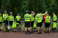 St John's Ambulance quick response team on The Mall. The Prudential RideLondon Sportives. Sunday 29th July 2018<br /> <br /> Photo: Andrew Baker for Prudential RideLondon<br /> <br /> Prudential RideLondon is the world's greatest festival of cycling, involving 100,000+ cyclists - from Olympic champions to a free family fun ride - riding in events over closed roads in London and Surrey over the weekend of 28th and 29th July 2018<br /> <br /> See www.PrudentialRideLondon.co.uk for more.<br /> <br /> For further information: media@londonmarathonevents.co.uk