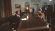 President Jimmy Carter delivers a nation wide television address on Afghanistan in the Oval Office in January 1980.  The photographer at work is George Tames.<br /> <br /> Photograph by Dennis Brack<br /> bb45