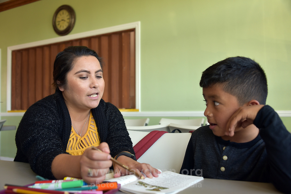 Program manager Anahi Alcibar helps Brian  Garcia with his homework at LIFE's after-school program in east Salinas.