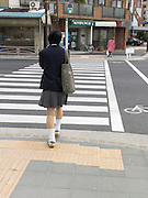 school child in uniform waiting to cross the road Yokosuka City
