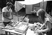 A couple preparing food outside Goose hall at Glastonbury, 1989