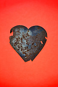 rusting metal red heart form still life