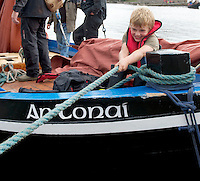 18/08/2013 Seven year old local Alfie Dwyer helps out on board An Tonai a Galway Hooker during  the annual Crinniu na mBad (The Gathering of the boats) Festival in the picturesque village of Kinvara Co. Galway. Picture:Andrew Downes