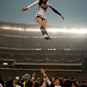 December 08, 2012:   The Navy Midshipmen cheerleaders do a flip during the game between The Navy Midshipmen and The Army  Black Knights for the 113 edition of the Army-Navy game at Lincoln Financial Field in Philadelphia, PA. The Navy Midshipmen defeated The Army Black Knights 17-13.  (Credit Image: © Kostas Lymperopoulos/Cal Sport Media)