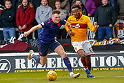 Gboly Ariyibi of Motherwell manages to get by Christophe Berra of Hearts during the Ladbrokes Scottish Premiership match between Motherwell and Heart of Midlothian at Fir Park, Motherwell, Scotland on 17 February 2019.