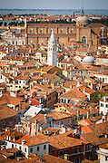 Tile roof tops and leaning bell tower of Santa Maria Formosa church from the Campanile San Marco, Venice, Veneto, Italy