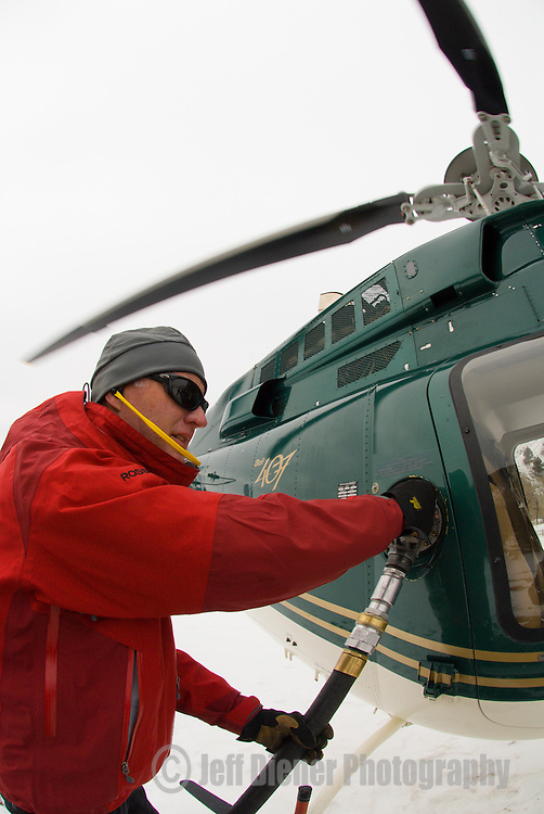 Jon Shick fuels up the heli at High Mountain Heli Skiing in Jackson Hole, Wyoming.