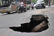 ZHENGZHOU, CHINA - MAY 25: (CHINA OUT) <br /> <br /> Road Subsidence<br /> <br /> A deep hole with almost three meters long and one meter wide caused by road subsidence is seen near Dongming Road on May 25, 2015 in Zhengzhou, Henan province of China. Road subsidence brought a deep hole with 12 square meters near Dongming Road in south China's Zhengzhou of Henan province at 3 p.m on Monday and percolating water under the communication tube lines was considered main reason according to Zhengzhou Urban Management Bureau. It\'s said that the repair plan had been in making and rescue work would be start after citizens's driving peak. <br /> ©Exclusivepix Media