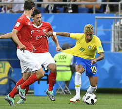 ROSTOV-ON-DON, June 17, 2018  Fabian Schaer (C) of Switzerland vies with Neymar (R) of Brazil during a group E match between Brazil and Switzerland at the 2018 FIFA World Cup in Rostov-on-Don, Russia, June 17, 2018. (Credit Image: © Chen Yichen/Xinhua via ZUMA Wire)