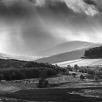 Passing rain showers over Cairn Gorm from Abernethy