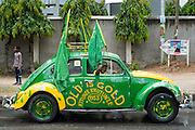 "Dar es Salaam, Tanzania - 10/30/15 - A man driving a Volkswagen Beetle with the slogan ""old is gold"" and and a slogan loosely translated to mean 'take care of it and it will take care of you' after an announcement ceremony for president-elect John Magufuli in Dar es Salaam, Tanzania on October 30.  Photo by Daniel Hayduk"