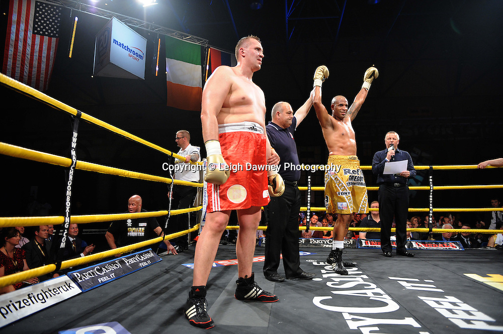 Gregory Tony (gold shorts) celebrates defeating Evgeny Orlov in Quarter Final 2 at Prizefighter International on Saturday 7th May 2011. Prizefighter / Matchroom. Photo credit © Leigh Dawney. Alexandra Palace, London.