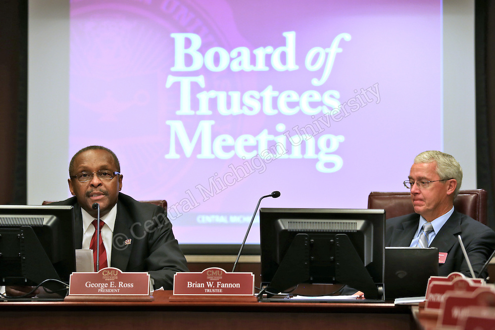 Brian Fannon (right) listens as CMU President George E. Ross (left) speaks as the Board of Trustees meet in the University Center on Thursday September 19, 2013.