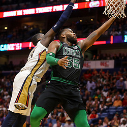 Mar 18, 2018; New Orleans, LA, USA; Boston Celtics center Greg Monroe (55) is defended by New Orleans Pelicans forward Cheick Diallo (13) during the second half at the Smoothie King Center. Mandatory Credit: Derick E. Hingle-USA TODAY Sports