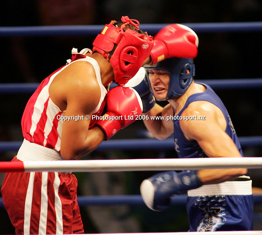 New Zealand's Kahukura Bentson (in blue) in action against Junior Greenidge from Barbados in the Middleweight 1/16 final at the XVIII Commonwealth Games, Melbourne, Australia, on Saturday 18 March, 2006. Photo: Joe Mann/PHOTOSPORT<br /> <br /> <br /> 150149