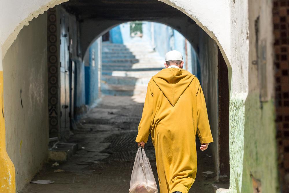 TETOUAN, MOROCCO - 6th April 2016 - Man carries shopping home through the Tetouan Medina, Rif region of Northern Morocco.