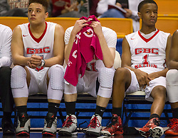 Greater Beckley Christian players react to losing to Magnolia during a semi-final game at the Charleston Civic Center.