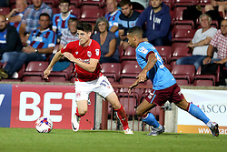 Callum O'Dowda of Bristol City goes past Jordan Clarke of Scunthorpe United - Mandatory by-line: Robbie Stephenson/JMP - 23/08/2016 - FOOTBALL - Glanford Park - Scunthorpe, England - Scunthorpe United v Bristol City - EFL Cup second round