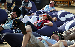 Spectators lay on giant bean bags watching the action on the big screen during day one of The Open Championship 2018 at Carnoustie Golf Links, Angus.
