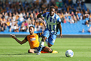 Brighton midfielder, winger, Kazenga LuaLua wins the ball in a battle with Hull City midfielder Ahmed Elmohamady during the Sky Bet Championship match between Brighton and Hove Albion and Hull City at the American Express Community Stadium, Brighton and Hove, England on 12 September 2015. Photo by Phil Duncan.
