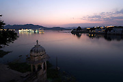 The Lake Palace Hotel sparkles at night on Lake Pichola, Udaipur, Rajasthan, India