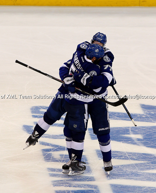 June 06 2015: Tampa Bay's Victor Hedman (77) hugs Jason Garrison (5) after Garrison's game winning goal in game two of the 2015 Stanley Cup Finals between the Chicago Blackhawks and the Tampa Bay Lightning at Amalie Arena in Tampa, Florida.