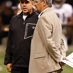 August 27, 2010; New Orleans, LA, USA; New Orleans Saints head coach Sean Payton and general manager Mickey Loomis talk on the field prior to the start of a preseason game at the Louisiana Superdome. The New Orleans Saints defeated the San Diego Chargers 36-21. Mandatory Credit: Derick E. Hingle