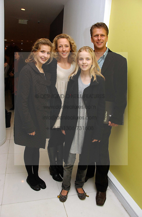 ANDREW CASTLE and his wife SOPHIA with their children, left GEORGINA and right CLAUDIA at the English National Ballet's Mad Hatters Tea Party at St.Martins Lane Hotel, St Martins Lane, London on 12th December 2006.<br />