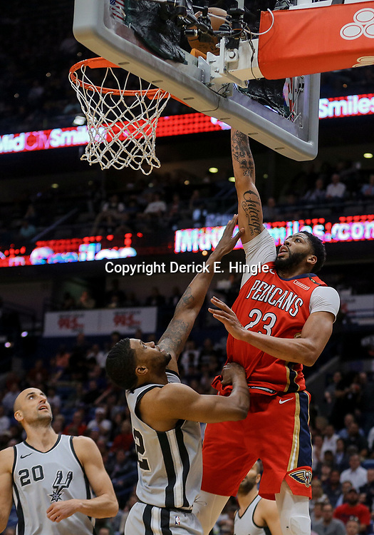 Apr 11, 2018; New Orleans, LA, USA; New Orleans Pelicans forward Anthony Davis (23) shoots over San Antonio Spurs forward Rudy Gay (22) during the first quarter at the Smoothie King Center. Mandatory Credit: Derick E. Hingle-USA TODAY Sports