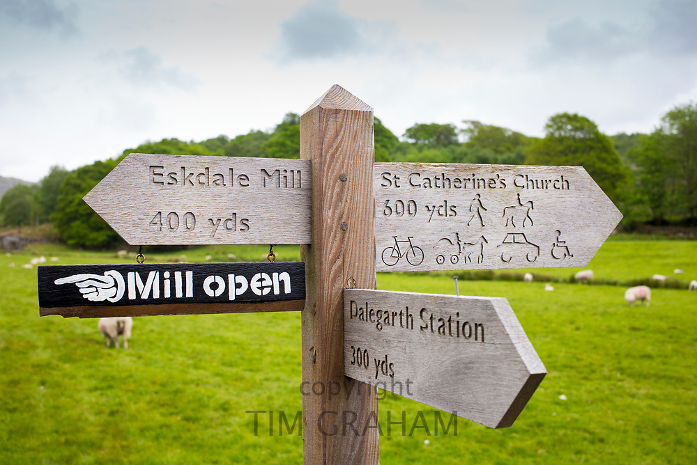 Signpost for public footpath, cycleway and bridleway towards Eskdale Mill in the Lake District, Cumbria, England