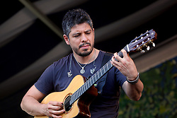 04 May 2012. New Orleans, Louisiana,  USA. .New Orleans Jazz and Heritage Festival. .Rodrigo Sánchez of the Mexican sensations 'Rodrigo and Gabriela' .Photo; Charlie Varley.