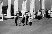 President and Mrs Hillery, with their daughter, Vivienne and son John, descend the steps of the specially-constructed alter in the Park, having received Communion from the Pontiff.<br />
