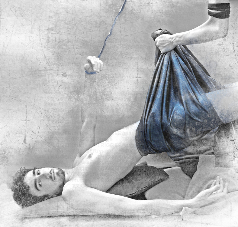 A naked young man suspended by blue fabric