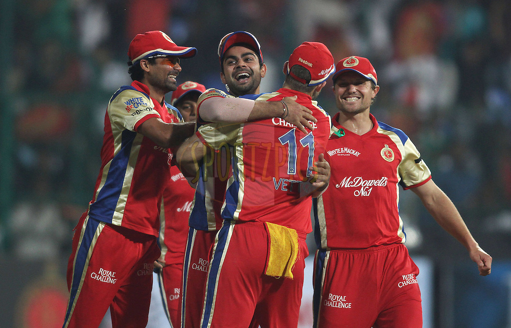 Royal Challengers Bangalore celebrate a wicket during match 1 of the NOKIA Champions League T20 ( CLT20 )between the Royal Challengers Bangalore and the Warriors held at the  M.Chinnaswamy Stadium in Bangalore , Karnataka, India on the 23rd September 2011..Photo by Shaun Roy/BCCI/SPORTZPICS