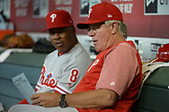 PHOENIX, AZ - JUNE 23:  Manager Pete Mackanin #45 and Juan Samuel #8 of the Philadelphia Phillies sit in the dugout the MLB game against the Arizona Diamondbacks at Chase Field on June 23, 2017 in Phoenix, Arizona. The Philadelphia Phillies won 6-1.  (Photo by Jennifer Stewart/Getty Images)