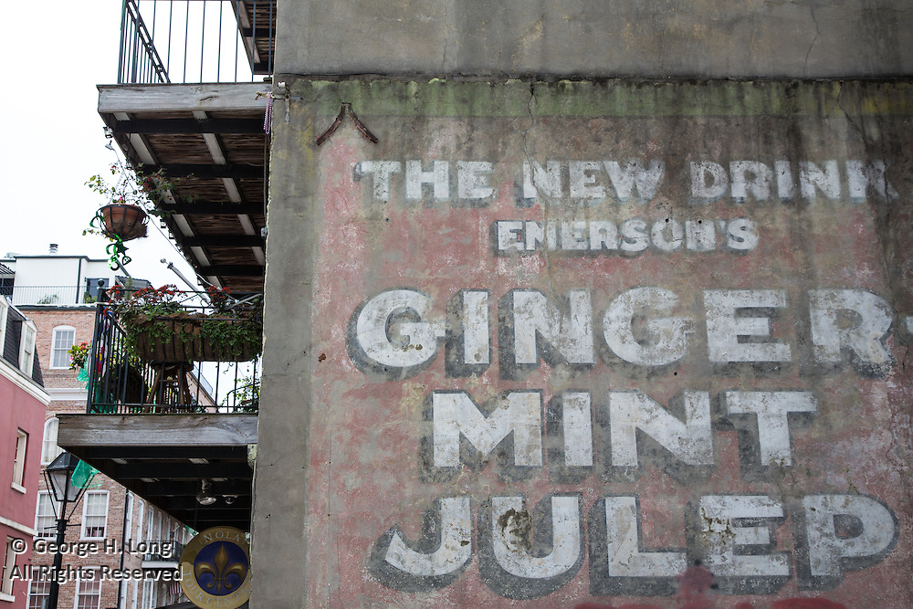 sign painted on exterior wall of home in the French Quarter advertising: The new drink.  Emerson's ginger-mint julep