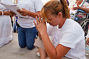 22 JULY 2010 -- PHOENIX, AZ: Maria Uribe (CQ) and others pray at an alter for the Virgin of Guadalupe in front of the courthouse Thursday. Thousands of people came to the Sandra Day O'Connor United States Courthouse (CQ) in downtown Phoenix Thursday. PHOTO BY JACK KURTZ
